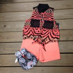 Orange and black combines on this astounding top from Hurley, which goes perfect with these shorts from Volcom, and sandals from Roxy.