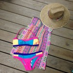 Spring time colors are abundant in this outfit that includes a swimsuit, dress, and hat fromRoxy.